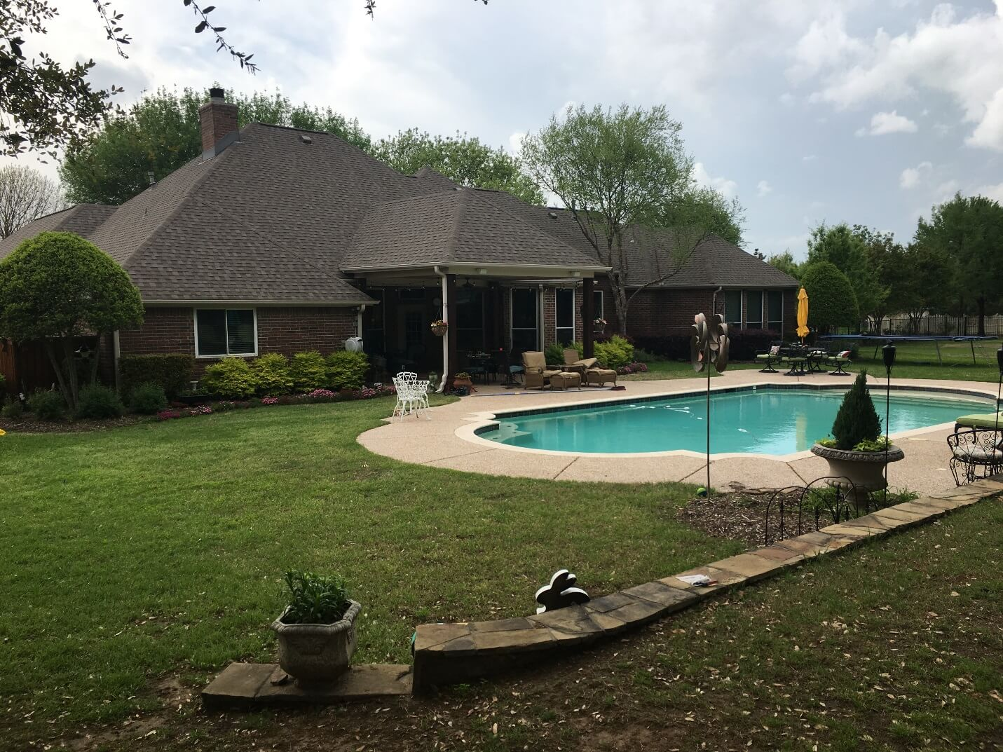 Backyard With Pool And Sitting Areas